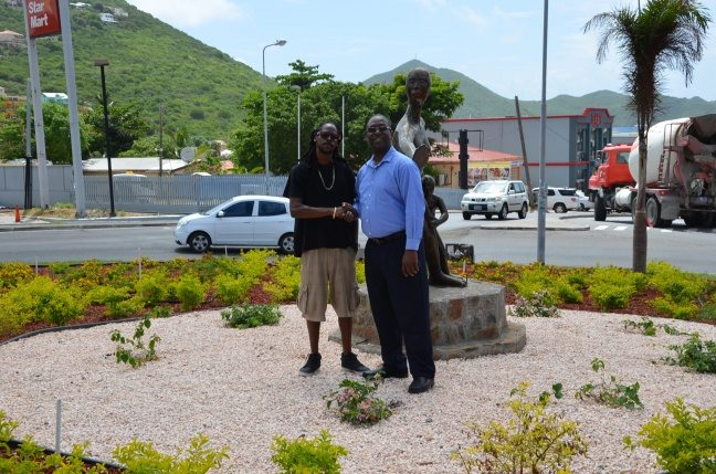 Minister Lake Commends Small Entrepreneur Spaceless Gardens for a Job well done at Church Hill Roundabout